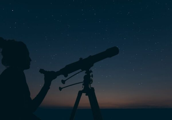 person looking into telescope